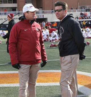 OU coach Bob Stoops, left, and OSU's Mike Gundy will be on opposing sidelines for Bedlam on Dec. 6 in Norman. Photo by Chris Landsberger, The Oklahoman archives