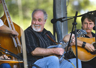 Ordained Baptist minister and Gospel artist Bobby Clark plays the mandolin with other musicians at the 17th annual Oklahoma International Bluegrass Festival in Cottonwood Flats Municipal Park in Guthrie. Photo by Jim Beckel, The Oklahoman. Jim Beckel - THE OKLAHOMAN