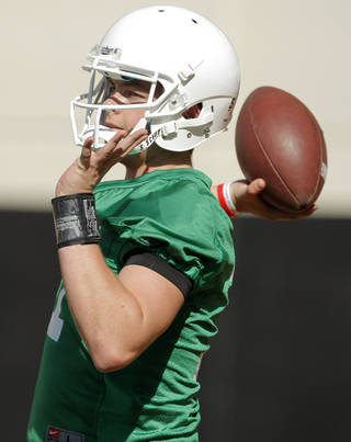 COLLEGE FOOTBALL: Wes Lunt (11) passes the ball during the OSU spring football practice at Boone Pickens Stadium on the campus of Oklahoma State University in Stillwater, Okla., Monday, March 12, 2012. Photo by Nate Billings, The Oklahoman
