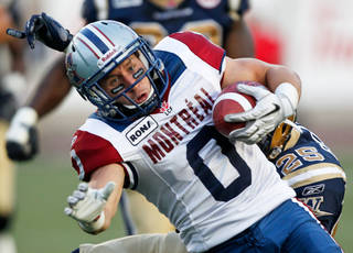 In this photo, Montreal Alouettes' wide receiver Bo Bowling scores a touchdown in the first quarter of a CFL preseason game against the Winnipeg Blue Bombers at Molson Stadium in Montreal in June 16, 2011. Bowling will return to training camp on June 2. Photo by Michelle Berg, The Montreal Gazette