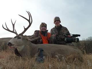 Kinta bull rider Austin Meier poses with the mule deer he killed in South Dakota. Also pictured is television cameraman Tyler Weaver. Meier has filmed hunts for outdoors shows such as Hard Core Hunting and PBR Outdoors. PHOTO PROVIDED