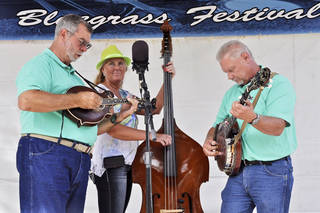 Ken Terral, left, Janis Lindsey and Gary Wilson comprise the band From the Heartland, from Moore. They took the stage at the Blanchard Bluegrass Festival. Photo by M. Tim Blake, for The Oklahoman M. Tim Blake