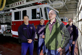 Bethany Firefighters Aaron Whitfield, Chris Allbritton, Brian Murray and Kyle Freeman, from left, pose for a photo at their station in Bethany on Friday. The department is fighting the firing of firefighter Josh Morgan after the department was awarded a raise through arbitration. Photo by Chris Landsberger, The Oklahoman CHRIS LANDSBERGER