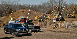 Crews work Feb. 4 on a section of the Keystone Pipeline where a woman locked herself to the pipeline in protest to protect Oklahoma waterways from Tar Sands. Photo by Chris Landsberger, The Oklahoman CHRIS LANDSBERGER - CHRIS LANDSBERGER