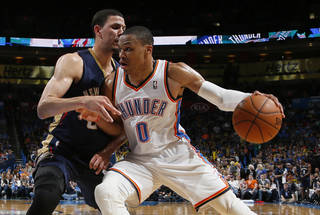 Oklahoma City's Russell Westbrook (0) tries to get past New Orleans' Austin Rivers (25) during an NBA basketball game between the Oklahoma City Thunder and the New Orleans Pelicans at Chesapeake Energy Arena in Oklahoma City, Friday, April 11, 2014. Oklahoma City won 116-94. Photo by Bryan Terry, The Oklahoman