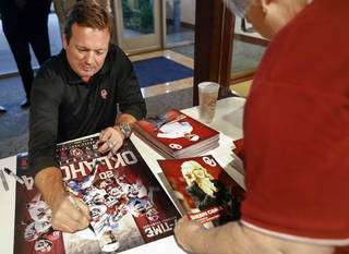 University of Oklahoma football coach Bob Stoops signs autographs for fans during the Sooner Caravan at the Jim Thorpe Museum in Oklahoma City, Okla. on Wednesday, July 30, 2014. Photo by Chris Landsberger, The Oklahoman