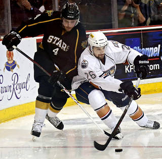 AHL HOCKEY PLAYOFFS: Oklahoma City's Mark Arcobello (26) gets the puck past Texas' Kevin Connauton (4) during the conference semifinal hockey game between the Oklahoma City Barons and the Texas Stars at the Cox Convention Center on Wednesday, May 15, 2013 in Oklahoma City, Okla. Photo by Chris Landsberger, The Oklahoman