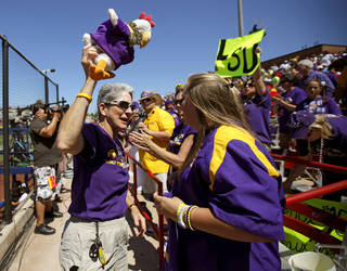 LOUISIANA STATE UNIVERSITY / COLLEGE SOFTBALL: LSU fan Beazie Maurin leads a cheer during a Women's College World Series game at ASA Hall of Fame Stadium in Oklahoma City, Thursday, May 31, 2012. Photo by Bryan Terry, The Oklahoman