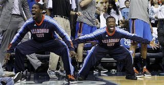 Oklahoma City Thunder guard Royal Ivey, left, and Nate Robinson, right, celebrate a teammate's score against the Memphis Grizzlies during the first half of Game 6 of a second-round NBA basketball playoff series on Friday, May 13, 2011, in Memphis, Tenn. (AP Photo/Lance Murphey)