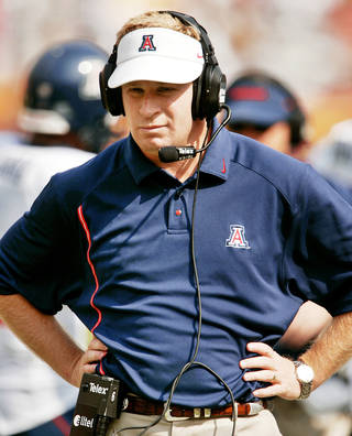 A Pac-16 super conference could pit Arizona coach Mike Stoops against his brother Bob on a yearly basis. AP PHOTO