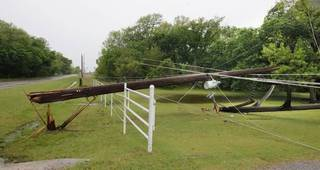 A power pole along the north side of Wilshire Blvd. just east of the Sara Road intersection downed by a thunderstorm that moved through overnight in Oklahoma City Thursday, May 8, 2014. Photo by Paul B. Southerland, The Oklahoman