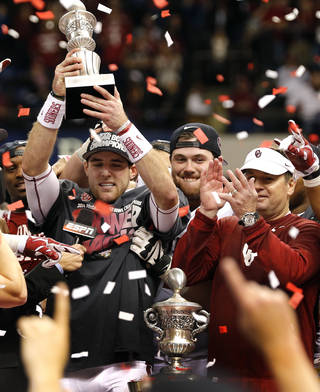Oklahoma's Trevor Knight (9) holds up the MVP trophy as the Sooners celebrate the 45-31 win over Alabama during the NCAA football BCS Sugar Bowl game between the University of Oklahoma Sooners (OU) and the University of Alabama Crimson Tide (UA) at the Superdome in New Orleans, La., Thursday, Jan. 2, 2014. .Photo by Chris Landsberger, The Oklahoman