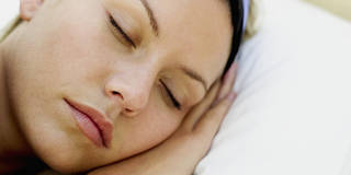 close-up of a young woman sleeping