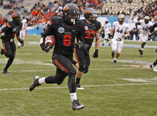 OSU COLLEGE FOOTBALL / BOWL GAME: Oklahoma State's Daytawion Lowe (8) runs a fumble recovery back for a touchdown during the Heart of Dallas Bowl football game between Oklahoma State University and Purdue University at the Cotton Bowl in Dallas, Tuesday, Jan. 1, 2013. Oklahoma State won 58-14. Photo by Bryan Terry, The Oklahoman