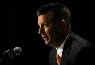 Oklahoma State head coach Mike Gundy answers questions during NCAA college football Big 12 Media Days, Monday, July 25, 2011, in Dallas. (AP Photo/Matt Strasen) Matt Strasen