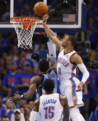 Oklahoma City's Russell Westbrook (0) blocks the shot of Memphis' Tony Allen (9) during Game 7 in the first round of the NBA playoffs between the Oklahoma City Thunder and the Memphis Grizzlies at Chesapeake Energy Arena in Oklahoma City, Saturday, May 3, 2014. Photo by Nate Billings, The Oklahoman