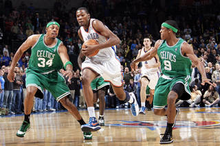 Oklahoma City's Kevin Durant, center, tries to get past Paul Pierce, left, and Rajon Rondo of Boston in the first half. Photo by Nate Billings, The Oklahoman