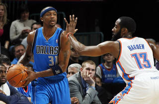 Jason Terry (31) of Dallas looks to pass around James Harden (13) of Oklahoma City during the NBA basketball game between the Dallas Mavericks and the Oklahoma City Thunder at the Oklahoma City Arena in Oklahoma City, Monday, Dec. 27, 2010. Dallas won, 103-93. Photo by Nate Billings, The Oklahoman