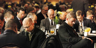 Participants bow their heads as a prayer is said at the 30th annual CBMC Metro Prayer Breakfast on Tuesday in downtown Oklahoma City.