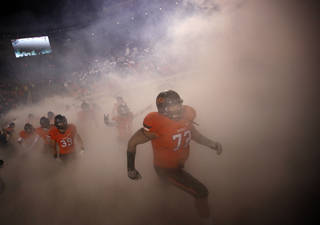 Oklahoma State's Christian Littlehead runs on to the field before the Bedlam college football game between the Oklahoma State University Cowboys (OSU) and the University of Oklahoma Sooners (OU) at Boone Pickens Stadium in Stillwater, Okla., Saturday, Dec. 3, 2011. Photo by Sarah Phipps, The Oklahoman