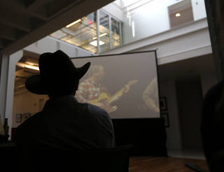 """Red Dirt Rangers' Brad Piccolo watches the music video for """"Stand (Let Your Voice Be Heard)"""" during a June 6 release party for the charity single, which is raising funds and awareness for health care issues musicians and artists face. The party was at the Hart Building in Oklahoma City. Photo by Sarah Phipps, The Oklahoman SARAH PHIPPS - SARAH PHIPPS"""