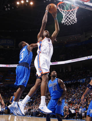NBA BASKETBALL: Kevin Durant goes up for a dunk between Dallas' Rodrique Beaubois (3) and Dominique Jones (20) during a preseason NBA game between the Oklahoma City Thunder and the Dallas Mavericks at Chesapeake Energy Arena in Oklahoma City, Tuesday, Dec. 20, 2011. Photo by Bryan Terry, The Oklahoman