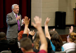 Dave Lopez, Oklahoma City Public School interim superintendent, takes a poll by show of hands inside U.S. Grant High School in Oklahoma City during a public forum on Tuesday, March 25, 2014. The forum gave those who wanted a chance to express their concerns over a plan to relieve overcrowding in southside schools by relocating students to northside schools. Photo by Bryan Terry, The Oklahoman