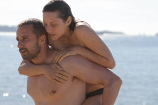 "This cautious and difficult romance between streetfighter Ali (Matthias Schoenaerts) and Stephanie (Marion Cotillard), a disabled former trainer at a Sea World-style marine park, takes place in the slums of paradise in ""Rust and Bone."" PROVIDED PHOTO"
