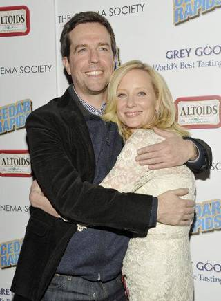 "Actors Ed Helms and Anne Heche attend a special screening of ""Cedar Rapids"" hosted by the Cinema Society at the SVA Theater in New York on Feb. 10. AP photo Evan Agostini"