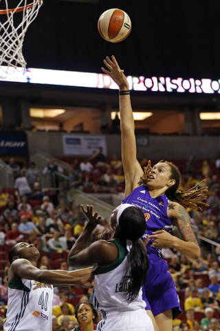 Phoenix center Brittney Griner powers between Seattle forwards Shekinna Stricklen and Crystal Langhorne, right, as the Seattle Storm take on the Phoenix Mercury in the final game of the season at KeyArena in Seattle Sunday, Aug. 17, 2014. (AP Photo/The Seattle Times,Bettina Hansen ) SEATTLE OUT; USA TODAY OUT; MAGS OUT; TELEVISION OUT; NO SALES; MANDATORY CREDIT TO BOTH THE SEATTLE TIMES AND THE PHOTOGRAPHER BETTINA HANSEN / THE SEATTLE TIMES.