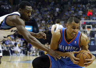 Oklahoma City's Thabo Sefolosha (25) grabs the ball in front of Memphis' Tony Allen (9) during Game 3 in the first round of the NBA playoffs between the Oklahoma City Thunder and the Memphis Grizzlies at FedExForum in Memphis, Tenn., Thursday, April 24, 2014. Memphis won 98-95. Photo by Bryan Terry, The Oklahoman