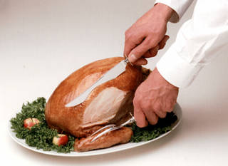 Carving the Thanksgiving turkey: Step 4: Continue to slice breast meat, starting the cut at a higher point each time. BUTTERBALL