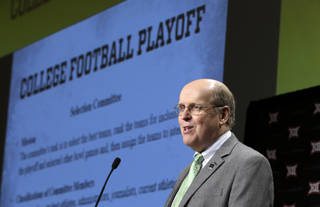 College Football Playoff executive director Bill Hancock speaks to the media at the Big 12 football media days. AP Photo