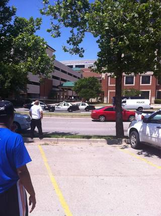 Police responded at 12:30 p.m. to a report of a person jumping from the top of a parking garage at the Courtyard by Marriott Oklahoma City Downtown, 2 West Reno Ave.. Photo by J.D. Reeves.