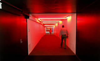 Pedestrians walk through the red tunnel of the Underground, which connects to the County Office Building to two nearby parking garages. This area is where officials think water began to flood the tunnels during the May 31st storm. Steve Gooch