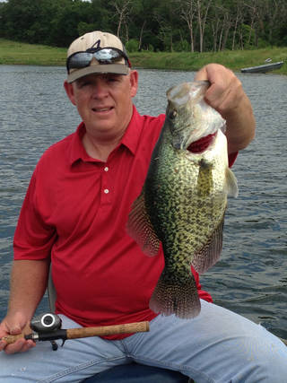 Crappie are still biting in Oklahoma. Former Oklahoma pitcher Scott Hamilton of Silo caught this 3 pound, 8 ounce slab on Memorial Day from a private lake near Madill. Hamilton was an All-Big Eight pitcher for the Sooners' baseball team in 1986. PHOTO PROVIDED
