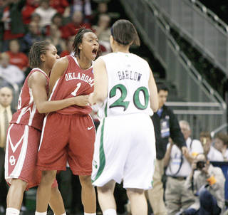 OU's Nyeshia Stevenson, right, and Jasmine Hartman celebrate after Stevenson made a basket in the final seconds of overtime in Kansas City, Mo., on Sunday. Photo by Bryan Terry, The Oklahoman