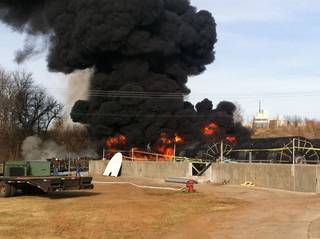 Rubber filters that caught on fire at the Wastewater Treatment Plant on Jenkins Avenue, south of State Oklahoma 9, sent black smoke spiraling into the air. PHOTO BY LYNETTE LOBBAN, FOR THE OKLAHOMAN