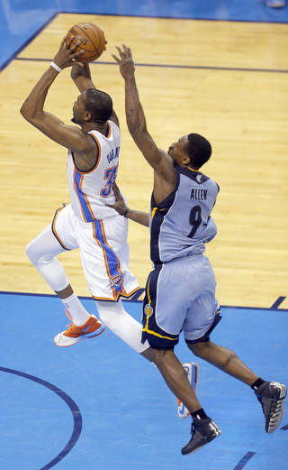 Oklahoma City's Kevin Durant (35) goes up for a dunk as Memphis' Tony Allen (9) defends during Game 2 in the first round of the NBA playoffs between the Oklahoma City Thunder and the Memphis Grizzlies at Chesapeake Energy Arena in Oklahoma City, Monday, April 21, 2014. Photo by Sarah Phipps, The Oklahoman