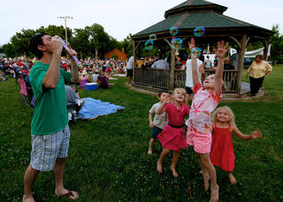 Lonnie Glidewell blows bubbles for children during a Summer Breeze concert last year in Norman. OKLAHOMAN ARCHIVES Mitchell Alcala