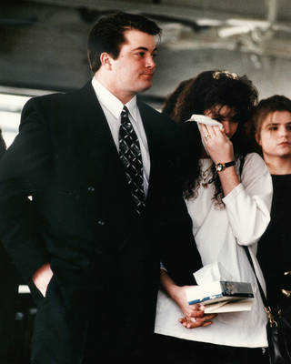 James Jarman and his wife, Alicia, were among the mourners at the funeral in Oklahoma CIty, Dec., 15, 1993, for Jarman's two children, Toyna, 5, and Timothy, 3, and their mother, Cynthia Lynn Jarman, 23. The three children were found shot to death. Photo by Steve Sisney, The Oklahoman