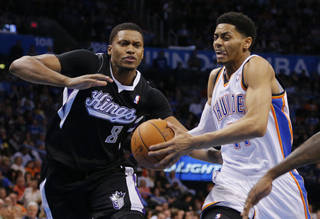 Oklahoma City's Jeremy Lamb (11) moves past Sacramento's Rudy Gay (8) during an NBA game between the Oklahoma City Thunder and the Sacramento Kings at Chesapeake Energy Arena in Oklahoma City, Friday, March 28, 2014. Oklahoma City on 94-81. Photo by Bryan Terry, The Oklahoman