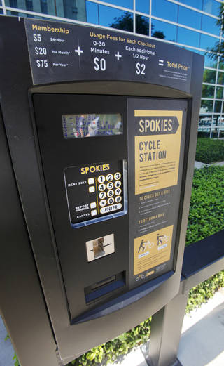 The checkout kiosk in front of the Ronald J. Norick Downtown Library for Spokies. The city's new bike sharing program, officially launched Friday. PAUL B. SOUTHERLAND - The Oklahoman