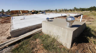 A house being built by builder-developer Marvin Haworth at 633 SW 6 in Moore. The storm shelter is left from the original house; 12 people took refuge during the May 20 tornado. PAUL B. SOUTHERLAND - The Oklahoman