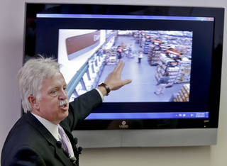 Midwest City police chief Brandon Clabes points to surveillance video as he speaks to the media on Friday, June 28, 2013 in Midwest City, Okla. about the incident in which Midwest City Police officer Capt. David Huff fatally shot suspect Sammie Wallace who was holding a knife to a female child's throat at the local Wal-Mart last week. Photo by Chris Landsberger, The Oklahoman