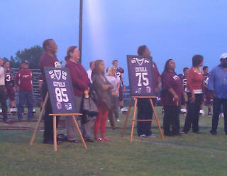 Selmon family members stand on the field at Eufaula during a ceremony retiring the numbers of Lee Roy, Dewey and Lucious Selmon on Friday, Sept. 28, 2012. PHOTO BY RYAN ABER, THE OKLAHOMAN
