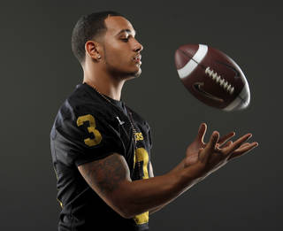 HIGH SCHOOL FOOTBALL: All-State football player Zeke Lewis, of Midwest City, poses for a photo in Oklahoma CIty, Wednesday, Dec. 14, 2011. Photo by Bryan Terry, The Oklahoman