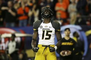 Missouri wide receiver Dorial Green-Beckham (15) celebrates his touchdown against Auburn during the first half of the Southeastern Conference NCAA football championship game, Saturday, Dec. 7, 2013, in Atlanta. (AP Photo/John Bazemore)