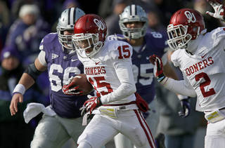 OU's Zack Sanchez, center, returns an interception for a touchdown during the Sooners' 41-31 win against Kansas State. Photo by Bryan Terry, The Oklahoman