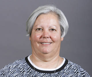 DeeAnn Wallar, Edmond North, tennis coach, poses for a mug at The Oklahoman's Spring high school sports photo day, Wednesday, Feb. 16, 2011, at the OPUBCO building in Oklahoma City. Photo by Sarah Phipps, The Oklahoman ORG XMIT: KOD